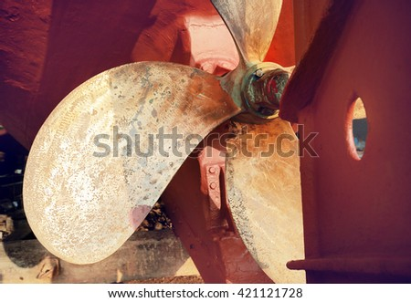 Propeller of a fishing boat in a shipyard for maintenance,retro color toned. - stock photo
