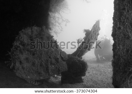 Propeller of a shipwreck underwater - stock photo