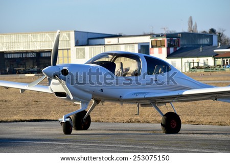 Propeller Plane on a Airport - stock photo