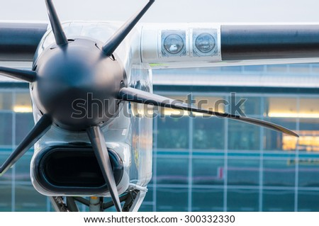 Propeller plane parking at the airport. Travel and destination background - stock photo