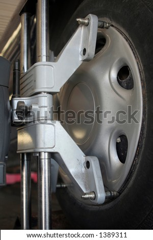 Proper attachment to wheel is important for precision alignment. Here a laser is used to align. - stock photo