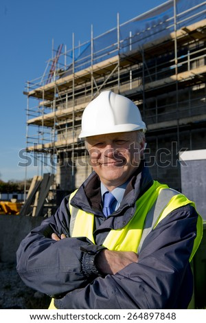 Property Developer -  Building Contractor With Arms Folded