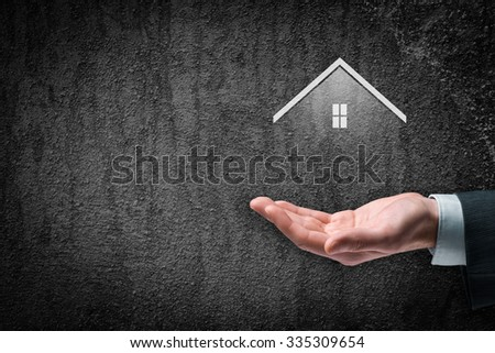 Property insurance and real estate agent concept. Care gesture of businessman and symbol of house. - stock photo