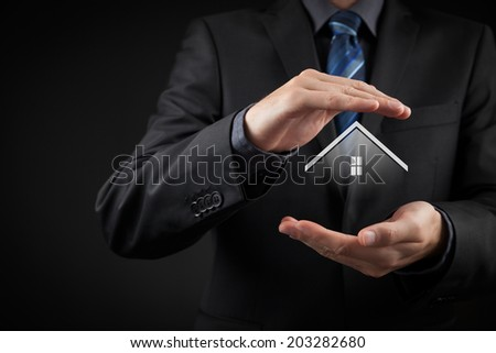 Property insurance and security concept. Protecting gesture of man and symbol of house. - stock photo