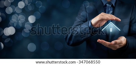 Property insurance and security concept. Protecting gesture of man and symbol of house. Wide banner composition with bokeh background. - stock photo