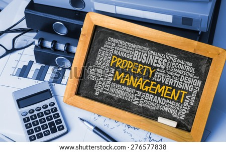 property management concept with related word cloud handwritten on blackboard - stock photo