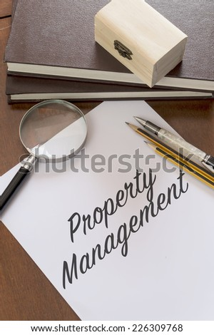 Property management written on paper - stock photo