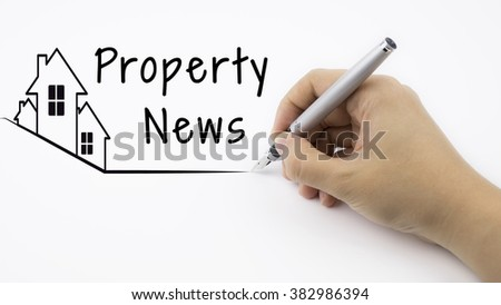 Property News - Real Estate concept with female hand and pen - stock photo