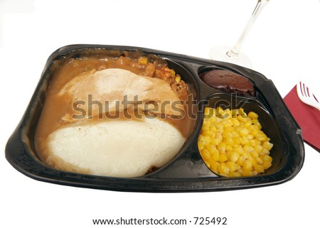 proportions for one this turkey supper with mashed potatoes yellow corn and chocolate brownie - stock photo