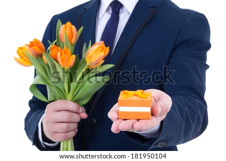 proposal - gift box with wedding ring and flowers in male hands isolated on white background - stock photo