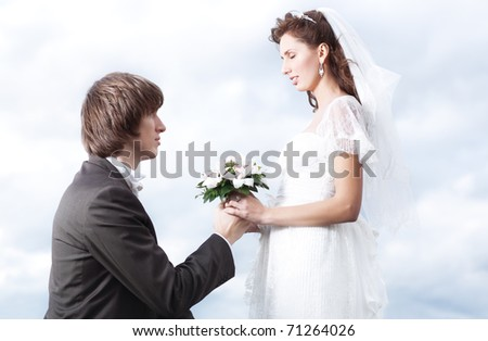 Proposal of marriage. Young couple portrait.