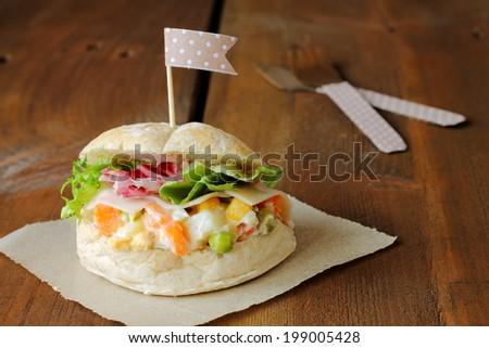 Prosciutto and russian salad sandwich - stock photo
