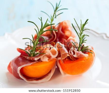 Prosciutto with apricots - stock photo