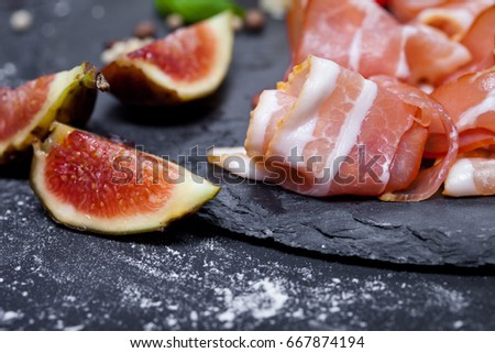 Prosciutto with figs and chili pepper, selective focus