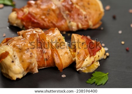 Prosciutto Wrapped Chicken. Selective focus. - stock photo