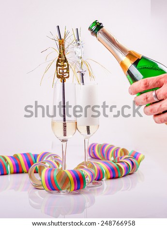prosecco, streamers and a bottle - stock photo