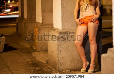 Prostitute waiting for client on the street - stock photo
