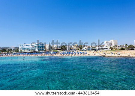 PROTARAS, CYPRUS - JUNE 12, 2016: Photo of sea and fig tree bay beach in protaras, cyprus island with swimming people and hotels.