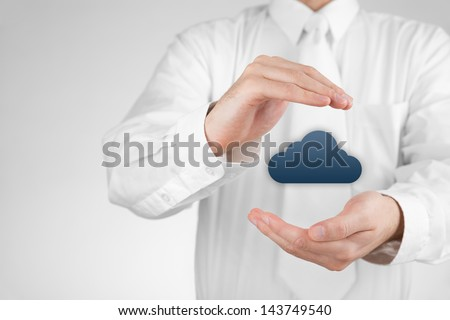 Protect cloud computing data concept. Security and safety of cloud computing. Protecting gesture of businessman and cloud icon. - stock photo