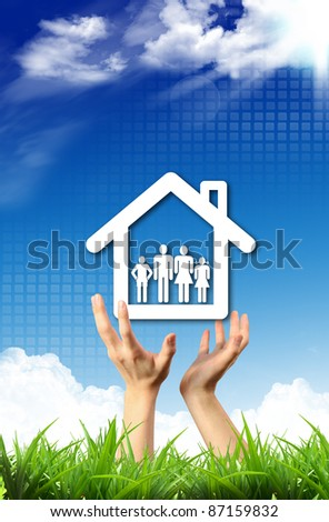 Protect family house in human hand - stock photo
