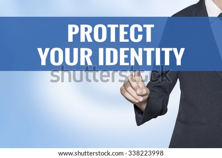 Protect Your Identity word on virtual screen touch by business woman blue background - stock photo