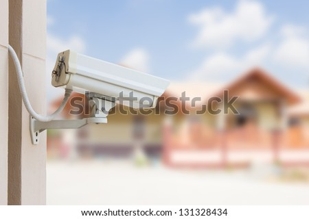 Protect Your Property With CCTV Camera - stock photo