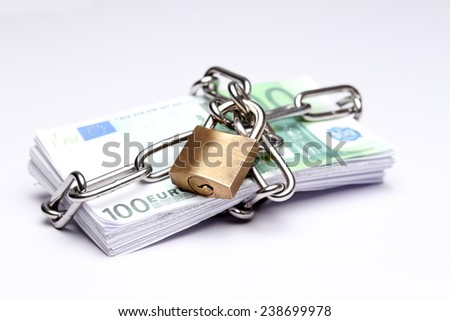 protected banknotes with lock and chain symbol - stock photo