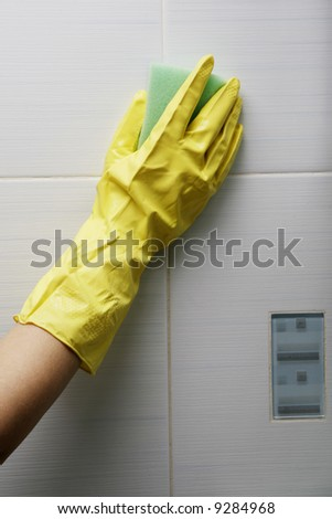 Protecting hand from detergents, use a cleaning sponge in the kitchen. - stock photo