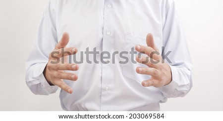 Protecting male hands  holding something - open space between them. Isolated on white background Copyspace for inscription or to insert your objects  - stock photo
