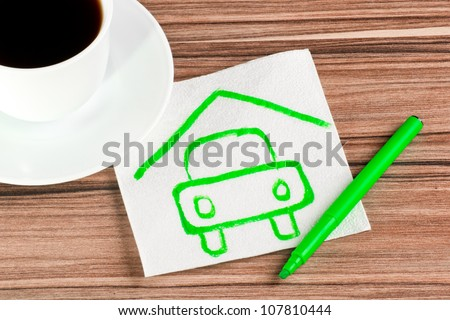 Protection auto on a napkin and cup of coffee - stock photo