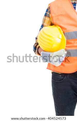 Protection equipment or uniform concept with engineer holding yellow helmet and wearing gloves and vest isolated on white