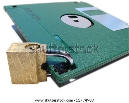 Protection of data. Information safety. A diskette on the lock - stock photo