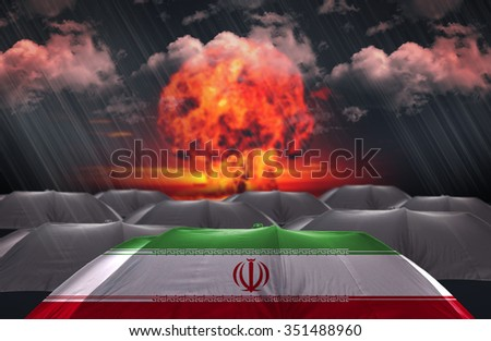 Protection Umbrella with flag of Iran on a war background - stock photo
