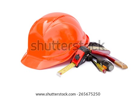 Protective construction helmet and tools on a white background - stock photo