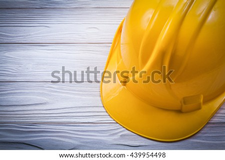 Protective hard hat on wooden board construction concept. - stock photo