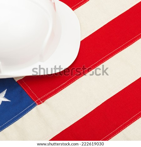 Protective helmet laying over US flag - 1 to 1 ratio