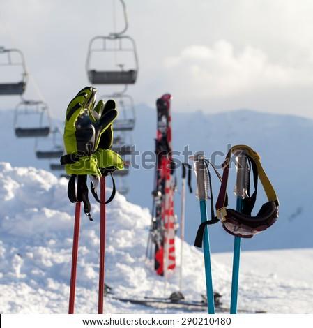 Protective sports equipments on ski poles at ski resort at sunny day  - stock photo