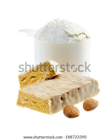 Protein bar and scoop of protein powder. - stock photo