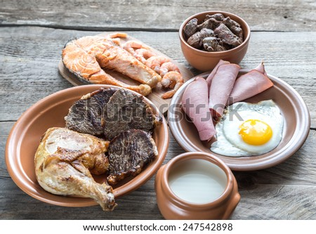Protein diet:cooked products on the wooden background - stock photo