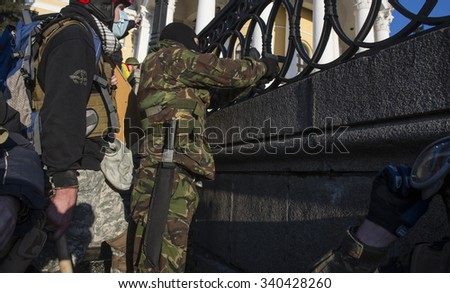 Protester fires a gun in the pro-government forces, Kyiv, Ukraine, February 18, 2014