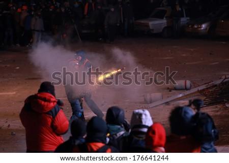 Protesters shoot fireworks at police. Kyiv, Ukraine, January 19, 2014 - stock photo