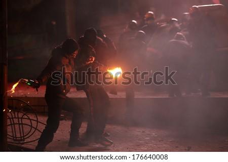 Protesters throw Molotov cocktails at police. Kyiv, Ukraine, January 19, 2014 - stock photo