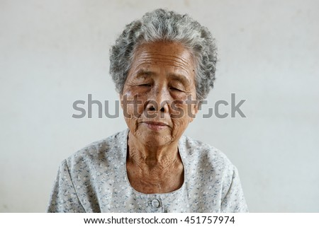 Protrait of senior asian woman on white background