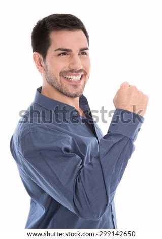 Proud and successful young business man making fist gesture isolated over white. - stock photo