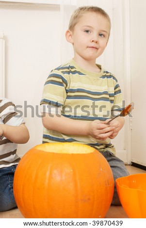 proud boy with his pumpkin - stock photo