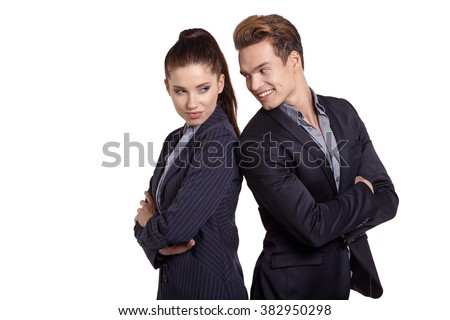 Proud business couple looking at camera isolated on white background