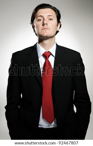 Proud business owner poses for a serious portrait - stock photo
