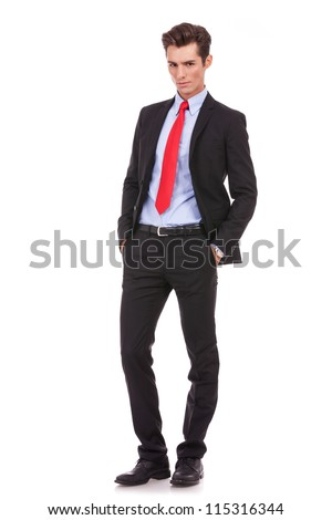 Proud business owner poses for a serious portrait on white background. Full body picture of a serious young business man looking at the camera - stock photo