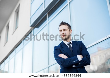 Proud Businessman In Front Of His Office