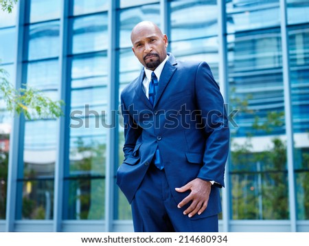 proud  businessman looking at camera - stock photo